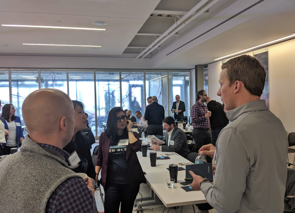 High Alpha data scientists in discussion at The Executive AI Summit.